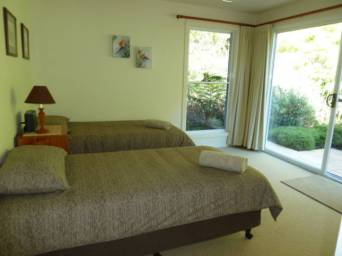 Second bedroom with two single beds and built in wardrobes